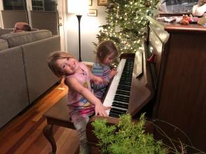 girls at a piano