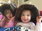 girls with poop emoji hats
