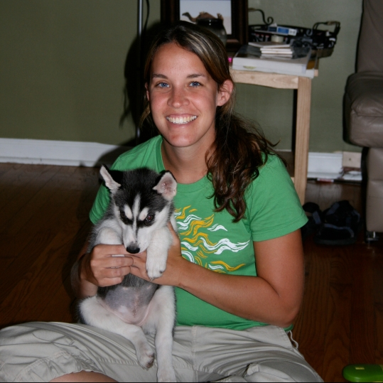 woman with husky puppy
