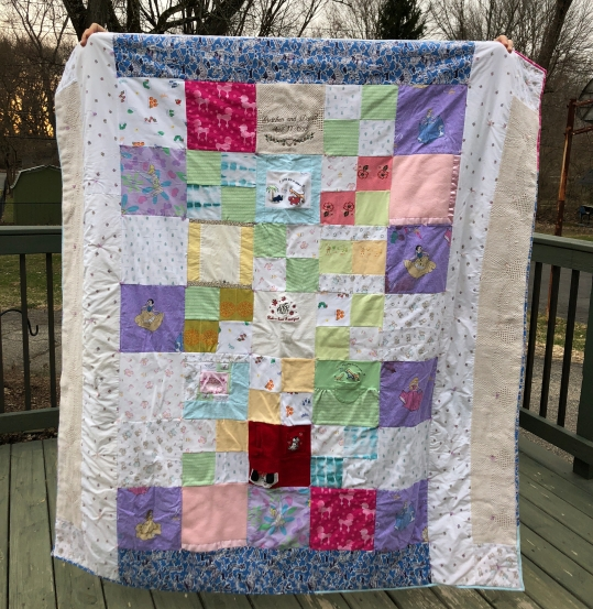 quilt with baby clothes