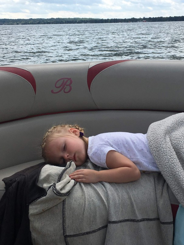 girl sleeping on a boat