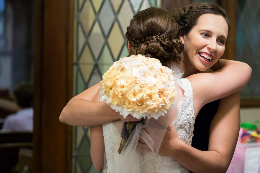 Two women hugging at wedding